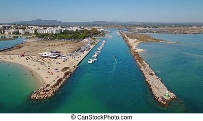 Aerial. The flight of a drone over village of Fusete, a view of docks and breakwaters.