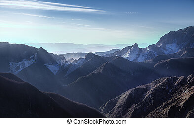 Alpi Apuane mountains and marble quarry view at sunset....