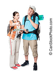 more lost perplexed tourists with backpacks and map on a...