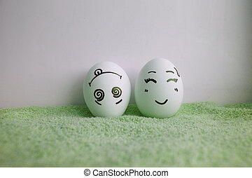 Eggs are funny with faces all up head on green - Eggs are...