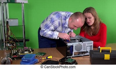 office guy fixing female computer. man and woman flirting at...