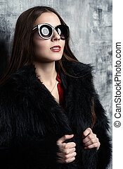 female sunglasses - Attractive young woman wearing black...
