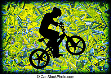 Boy on a Bike Silhouette - The silhouette of a boy riding a...