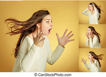 Portrait of young woman with shocked facial expression on...