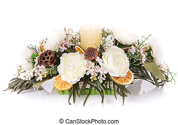 composition of flowers and candles to decorate a home...