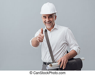 Construction engineer giving a thumbs up