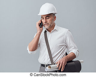 Construction engineer using a smartphone