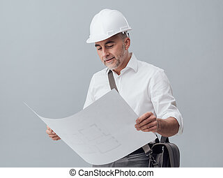 Architect checking a blueprint