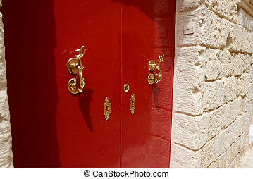The red door of house at Mdina town, Malta