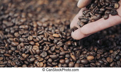 hands pouring coffee in slow motion.
