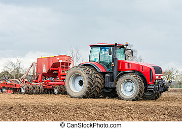 Farmer tractor working in the field. Spring time for sowing....
