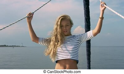 Smiling young woman on yacht deck