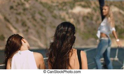 Beautiful girls with camera on the yacht - Beautiful girls...