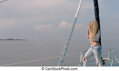 Young attractive blonde woman on deck of yacht - Young...