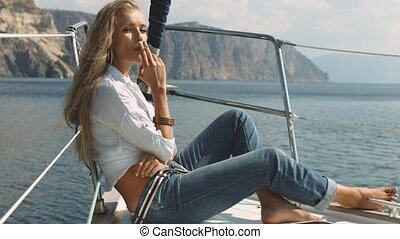 Sexy girl smokes on a yacht - Sexy girl smokes at luxury...