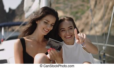 Young beautiful girls making photo on the yacht - Young...