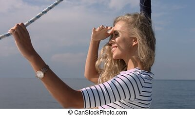 Attractive girl on a yacht at summer day - Sexy cheerful...