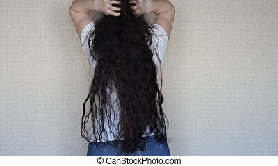 Brunette girl with very long and thick hair