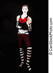 Mime with a big red bow on a black background