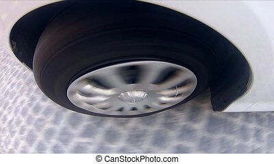 Car Wheel Rolling Close Up - Pov Of Car Tire, white car...