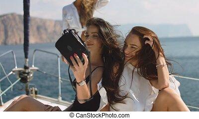Beautiful girls taking a selfie on a white yacht - Beautiful...