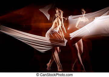 The sensual and emotional dance of beautiful ballerina with...