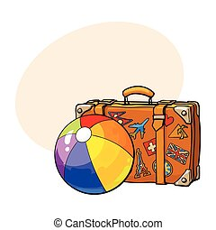 Travel suitcase with colorful labels and rainbow colored...