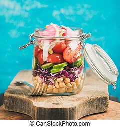 Vegetable and chickpea sprout vegan salad in jar, square...