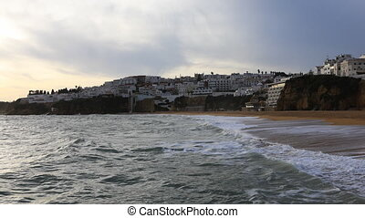 Timelapse of the beach at Albufeira, Portugal at dusk