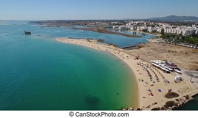 Aerial. Beaches with tourists in Fuseta. Ria Formosa Tavira