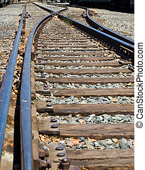 Old Railroad Tracks at a Junction on a Sunny Day