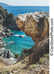Rock over chasm and beautiful natural lagoon down, Turkey -...