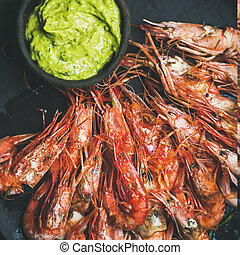 Roasted red shrimps with guacamole avocado sauce, square...