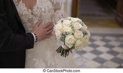 Bride and groom embracing slowmotion indoors
