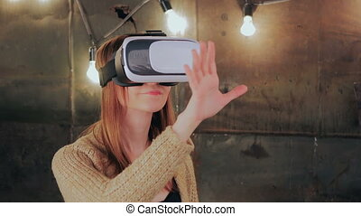 Young woman using Virtual Reality Glasses