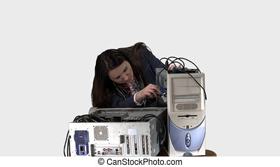 Frustrated woman trying to repair computer system unit....