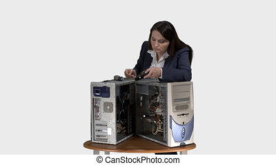 Frustrated woman trying to repair computer system unit.