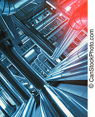 Industrial zone, Steel pipelines and cables in blue tones -...