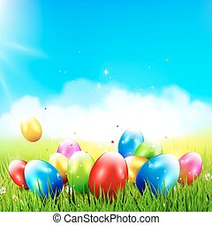 Easter background with colorful eggs in the grass and with...