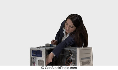 Frustrated woman trying to repair computer system unit. Alpha channel
