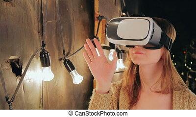 Young woman using Virtual Reality Glasses. Virtual reality...