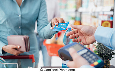 Woman at the store checkout - Woman at the supermarket...