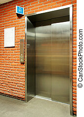 Vertical steel door elevator