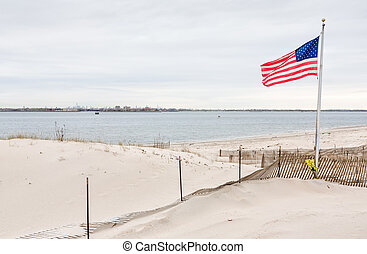 American flag on Breezy Point - American flag on the beach...
