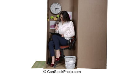 Business woman working inside cardboard box as a very small...