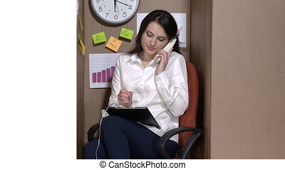 Office worker working in a cardboard box. Business woman...