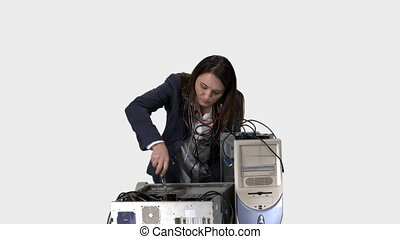 Frustrated woman trying to repair computer system unit. -...