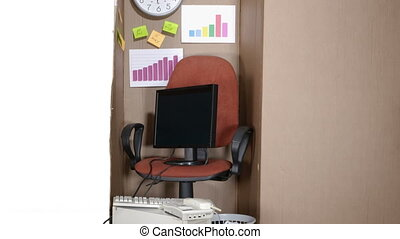 Simple small office in a cardboard box with computer desktop...
