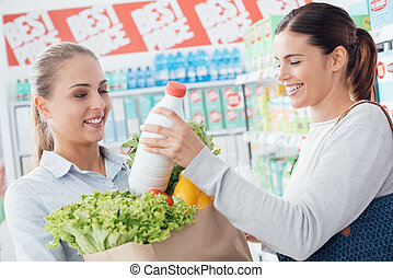 Women shopping together at the supermarket - Happy women...
