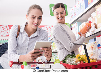 Friends shopping together - Happy female friends shopping...